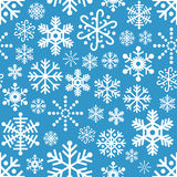White Snowflakes Seamless Pattern on Blue. A Christmas or winter seamless pattern with white snowflakes, isolated on blue background. Eps file available Stock Images
