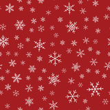 White snowflakes seamless pattern on red. Royalty Free Stock Photography