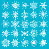 White Snowflakes Set on Blue Background. Vector Snowflakes Set. Thin snowflakes, intricate shape. Fine Christmas decoration for Christmas card, Christmas sale Royalty Free Stock Photos