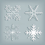 White snowflakes with shadow. White 3d snowflakes with shadow on gray background. Editable vector format Stock Images