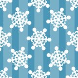White snowflakes on striped blue background. Drawn by hand. Seamless pattern. stock illustration