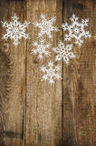 White snowflakes on wooden background. christmas decoration Stock Photos