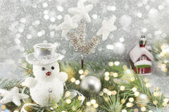 White snowman among decorated fir branches Royalty Free Stock Images