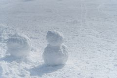 White snowman on the ski field. White snowman on the snow field hill in ski resort Stock Photos