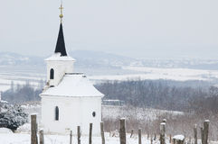 White snowy chapel on the hill Stock Photography