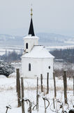 White snowy chapel on the hill Stock Photo
