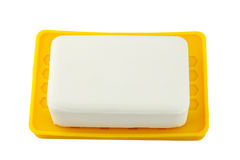 White soap on yellow holder isolated on white background Royalty Free Stock Images