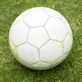 White soccer ball. Pure white soccer ball on grass Royalty Free Stock Photo