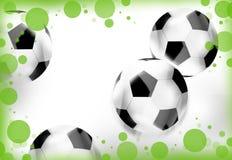 White soccer balls green dots grass Stock Photography