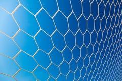 White soccer or football goal net against clear blue sky Stock Photography