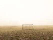 White Soccer Goal on Green Grass Field Surrounded by White Fog Royalty Free Stock Photo