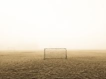 White Soccer Goal on Green Grass Field Surrounded by White Fog Stock Photography