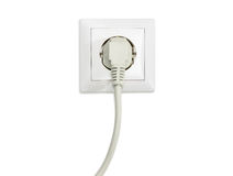 White socket outlet with connected corresponding power plug. White socket outlet European standard with connected white power cable with corresponding AC power stock images
