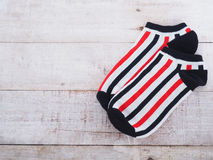 White socks with black and red striped Stock Photo