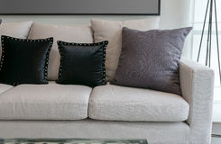White sofa with black and grey pillows in living room Stock Image
