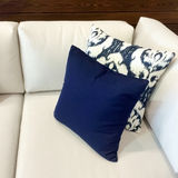 White sofa with blue cushions Royalty Free Stock Photography
