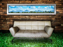 White sofa Brick Wall and Green Grass. Nature picture White Sofa Old Brick Wall and New Green Grass Stock Photography