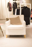 White sofa clothing store Stock Images