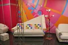 White sofa, color spots Stock Photos