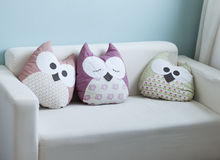 White sofa with cute owl pillows Stock Photography