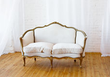 White sofa with fabric upholstery in a room Stock Photography