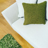 White sofa with green cushion Royalty Free Stock Photo