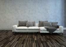 White Sofa with Grey Cushions in Bare Room Royalty Free Stock Photos