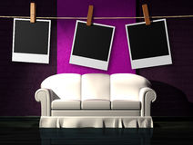 White sofa with instant photos frames on the rope Royalty Free Stock Image