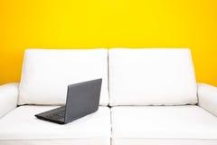 White sofa and laptop Royalty Free Stock Photos