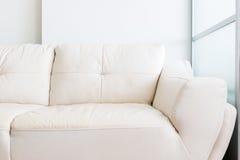 White sofa near glass partition Royalty Free Stock Photos