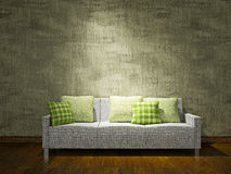 White sofa near the wall. White sofa with pillows near the concrete wall Royalty Free Stock Photography
