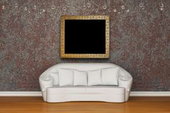 White sofa with picture frame Royalty Free Stock Photography