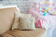 White sofa in a Provence style with well decorated pillows Stock Photos
