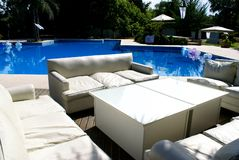 White Sofa whith pool. A beautifull Pool with sofa Stock Photography