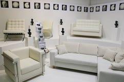 White sofas. Many white sofas, easychairs, white walls Royalty Free Stock Photography