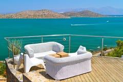 White sofas at Mirabello Bay on Crete. White sofas with Mirabello Bay view on Crete Royalty Free Stock Photos