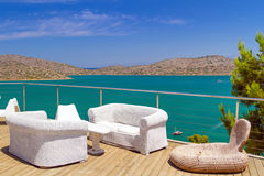 White sofas with Mirabello Bay view Stock Photography
