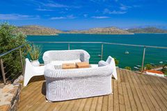 White sofas with Mirabello Bay view Royalty Free Stock Photography