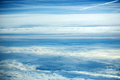 White soft clouds on idyllic blue sky. Celestial sphere on sunny day on fluffy overcast background. Upper layers of atmosphere Stock Image