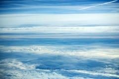 White soft clouds on idyllic blue sky Stock Image