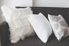 White soft cushion on sofa Stock Image