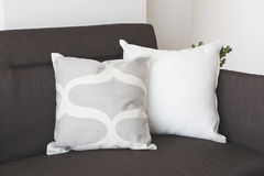 White soft cushion on sofa stock photos