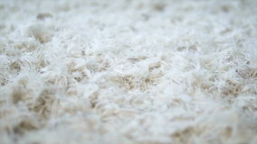 White soft feathers falling down stock video