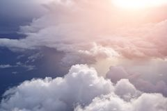 Free White Soft Fluffy Clouds Over The Green Landscape, Aerial View From The Plane. Stock Photos - 165248203