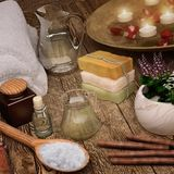 White soft spa towels and spa products with candles. Square Royalty Free Stock Photos