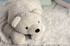 White soft toy bear. In a children's room royalty free stock images