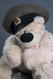White soft toy - Teddy Bear. Soft toy - Teddy Bear in a cap with a cockade of the Soviet Royalty Free Stock Images