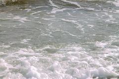 White soft wave rolling splash on empty tropical sandy beach in sunny day stock image