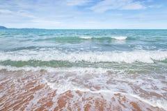 White soft wave rolling splash on empty tropical sandy beach royalty free stock photos