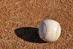 White Softball on the Infield Stock Photos